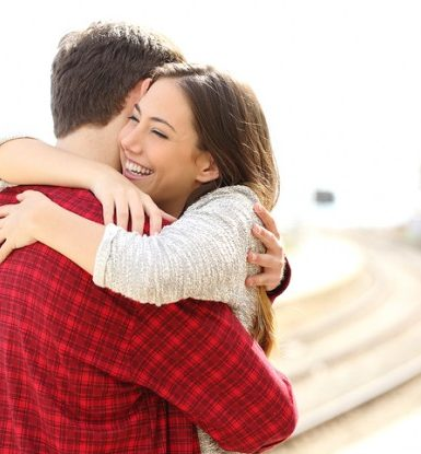 bigstock-Couple-Hugging-Happy-In-A-Trai-91870817-776x415